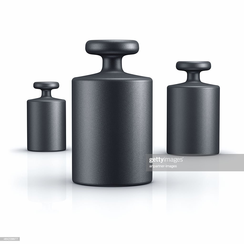 Black weights of different size on white