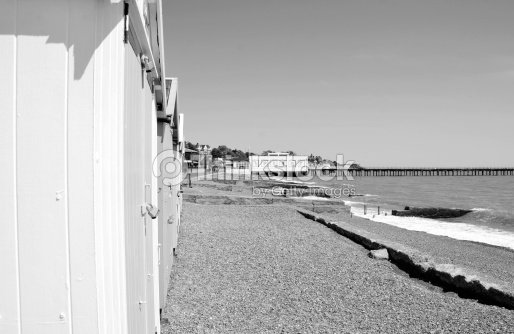 Black white beach huts stock photo