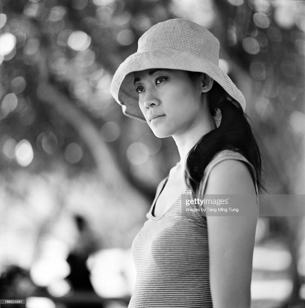 Black & white portrait of a pretty young woman : Stock Photo