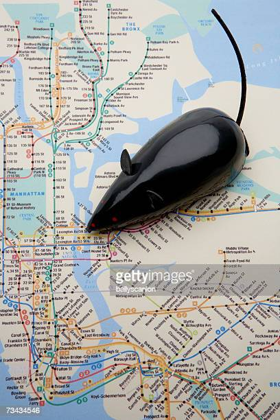 Black wind-up mouse on Manhattan subway map