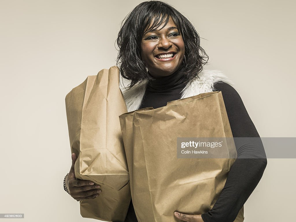 Black woman carrying shopping bags : Stock Photo