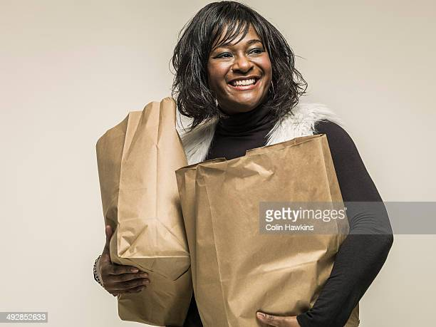 Black woman carrying shopping bags