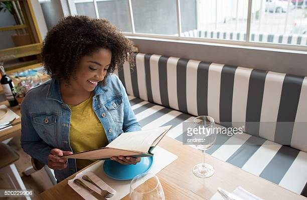 Black woman eating at a restaurant