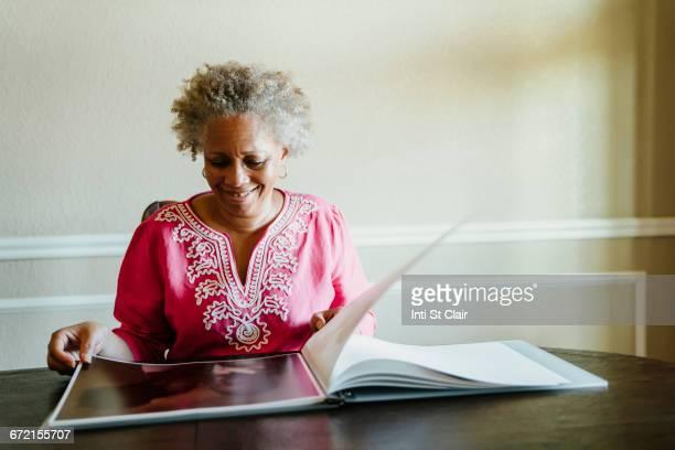 Black woman enjoying photo album