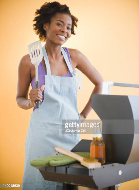 Black woman grilling on barbecue