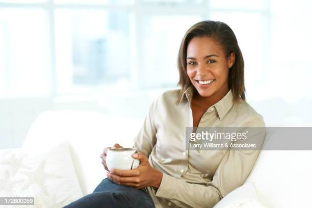 Black woman having cup of coffee