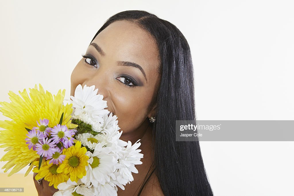 Black Woman Holding Bouquet Of Flowers Stock Photo | Getty ...