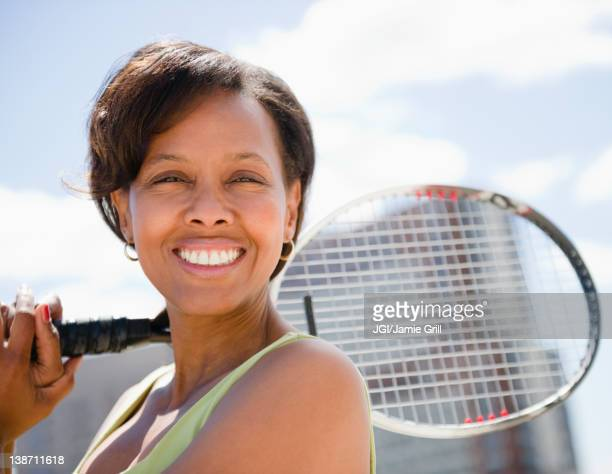 Black woman holding tennis racquet