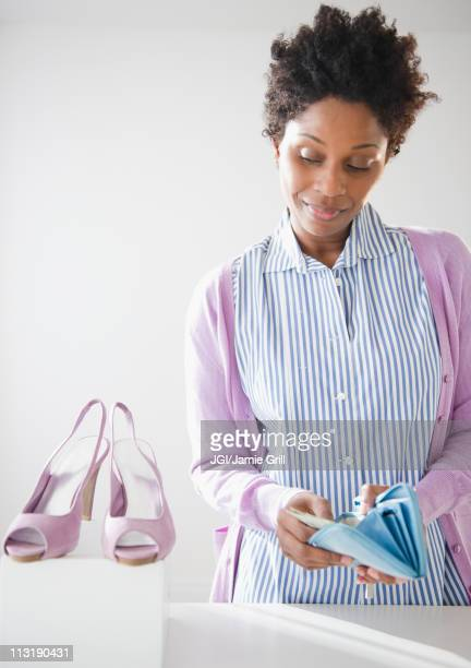 Black woman paying for new shoes