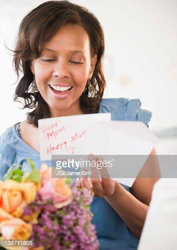 Black woman receiving bouquet of flowers