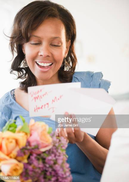 Black woman receiving bouquet of flowers