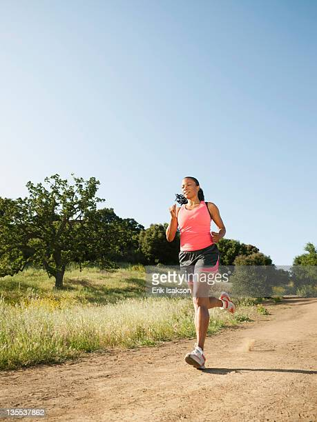 Black woman running on remote trail