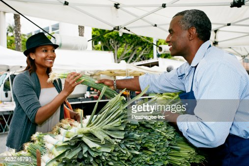 Black woman shopping at outdoor market