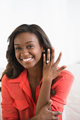 Black woman showing off engagement ring