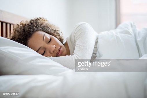 Black woman sleeping in bed