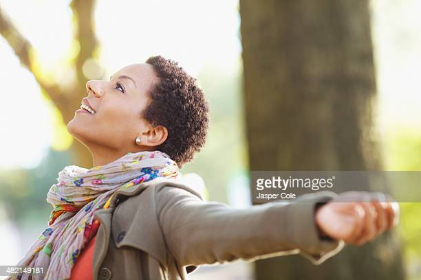 Black woman standing outdoors