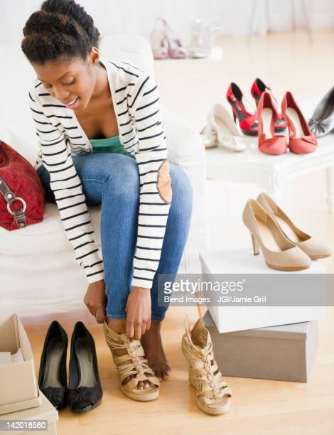 Black woman trying shoes on in store