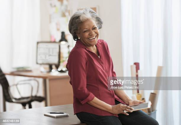 Black woman using digital tablet