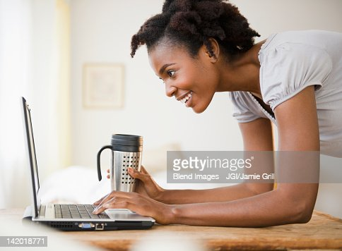 Black woman using laptop : Stock Photo