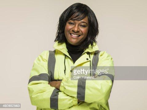 Black woman wearing high visibilty jacket