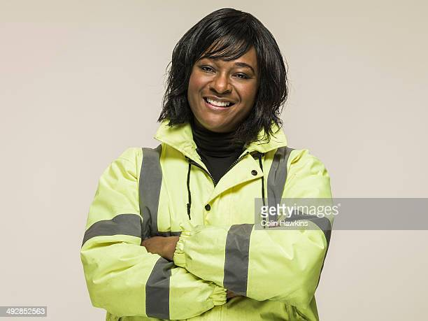 Black woman wearing high visibilty jacket
