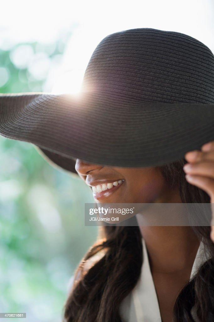 Black woman wearing sun hat