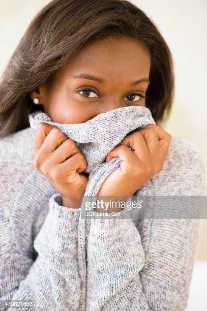 Black woman wearing warm sweater