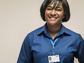 Black woman wearing work identity lanyard