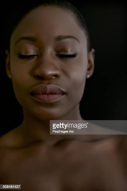 Black woman with eyes closed