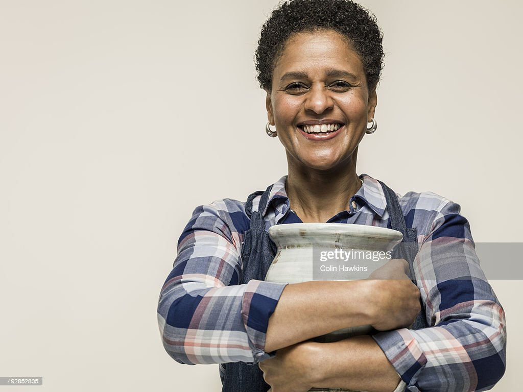 Black woman with hand crafted pottery vase