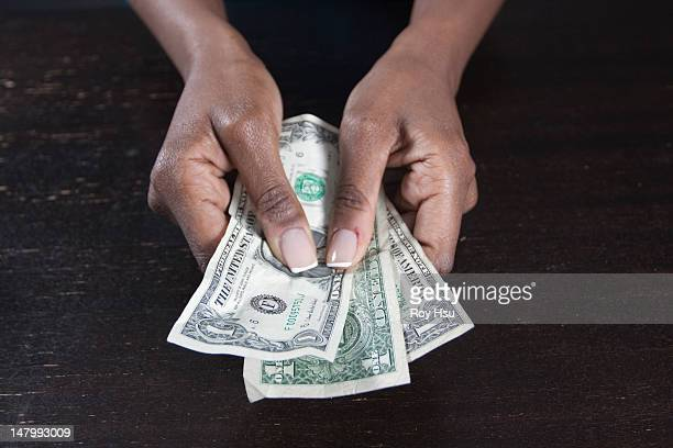 Black woman with money in her hands
