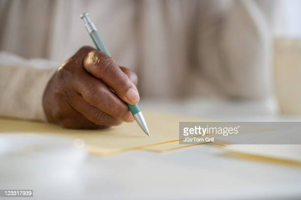 Black woman writing letter