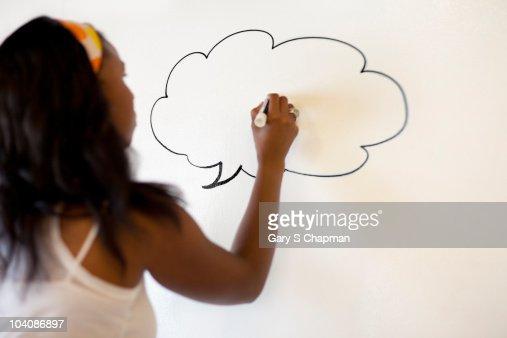 Black woman writing on whiteboard : Stock Photo