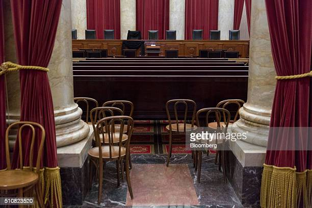 A black wool crepe sits draped over Justice Antonin Scalia's bench chair in the Supreme Court courtroom in Washington DC US on Wednesday Feb 17 2016...