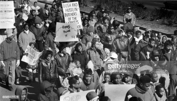 Black youth taking part in a pride march make their way down Blue Hill Avenue to Chez Vous RollAWay in Mattapan Feb 23 1991