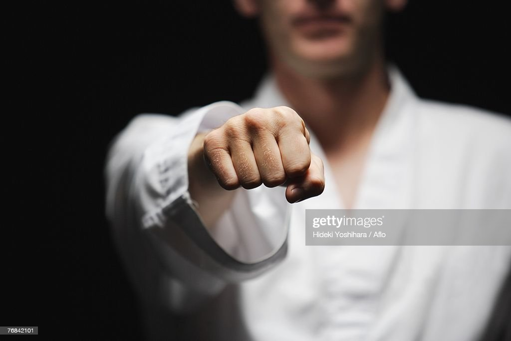 Blackbelt Doing a Front Punch : Stock Photo