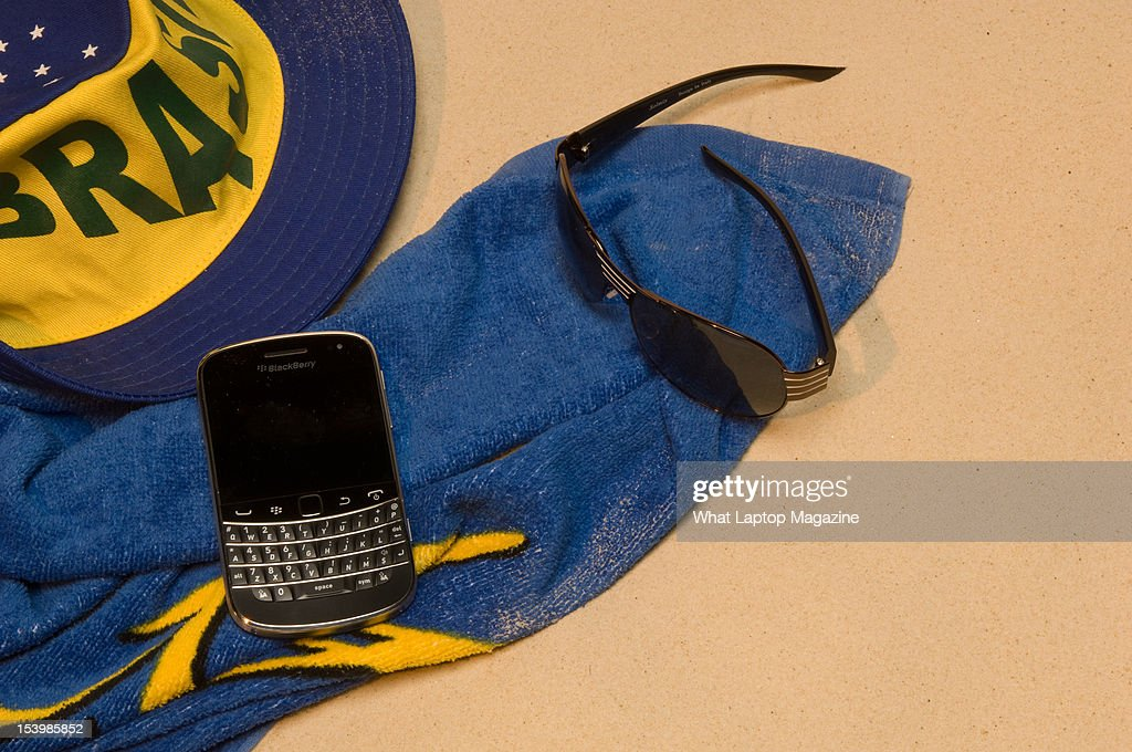 A BlackBerry Bold 9900 phone, shot in a beach scenario during a holiday technology feature, February 6, 2012.