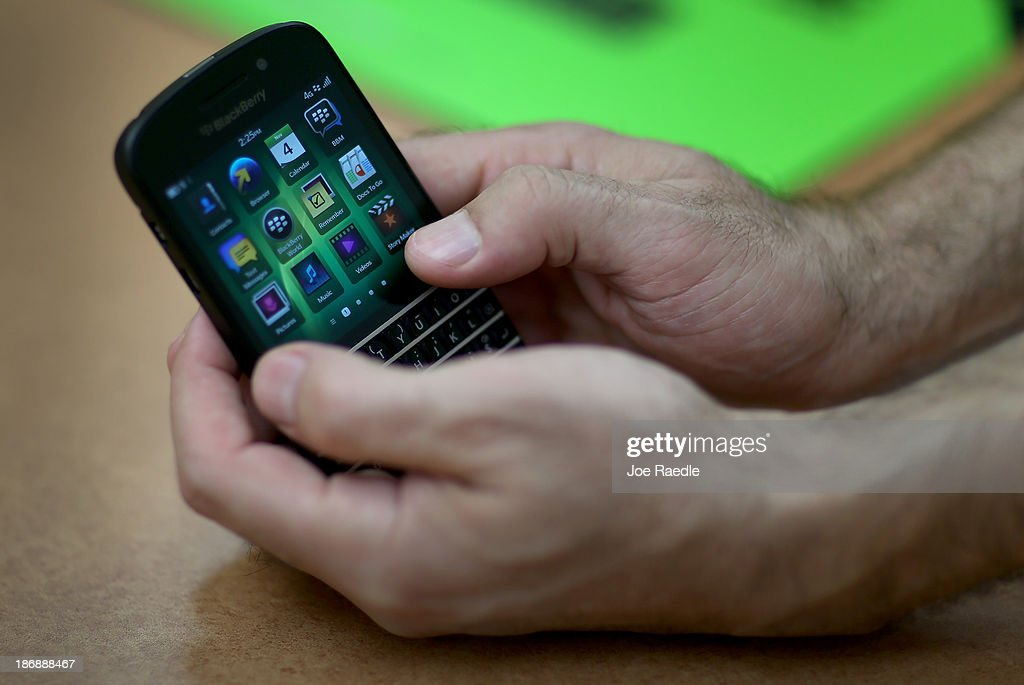 A Blackberry cell phone is seen at Fixx wireless on November 4, 2013 in Miami, Florida. Blackberry announced today it has abandoned plans to sell the company and that CEO Thorsten Heins will be leaving the company and step down from the board.