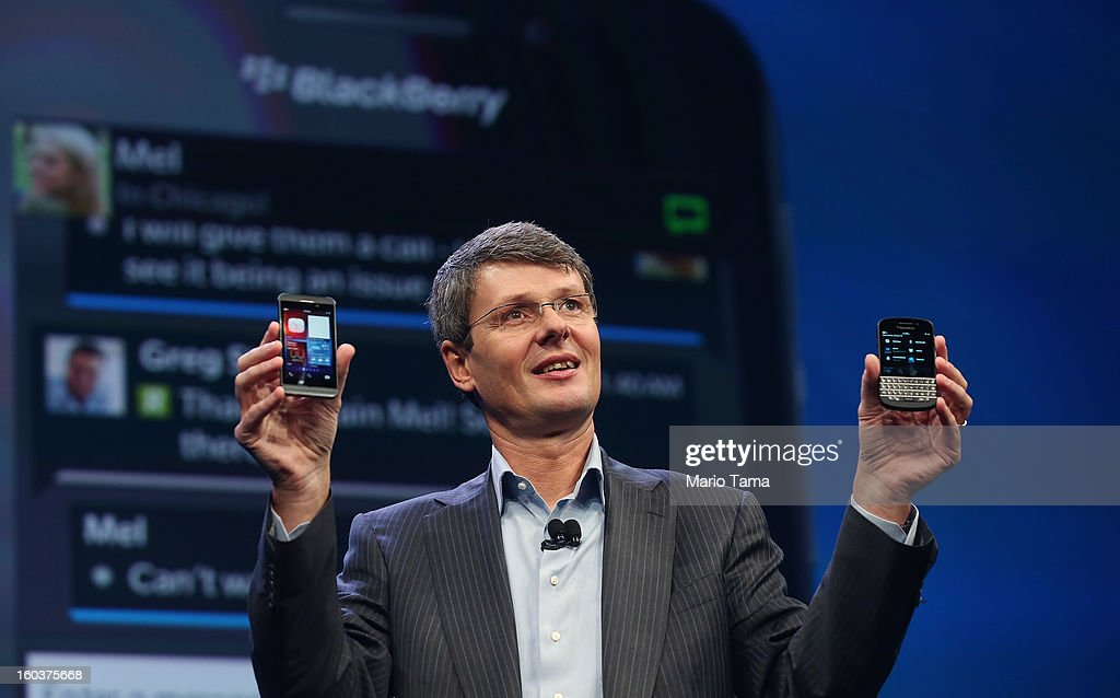 BlackBerry Chief Executive Officer Thorsten Heins displays the new Blackberry 10 smartphones at the BlackBerry 10 launch event by Research in Motion at Pier 36 in Manhattan on January 30, 2013 in New York City. The new smartphone and mobile operating system is being launched simultaneously in six cities.