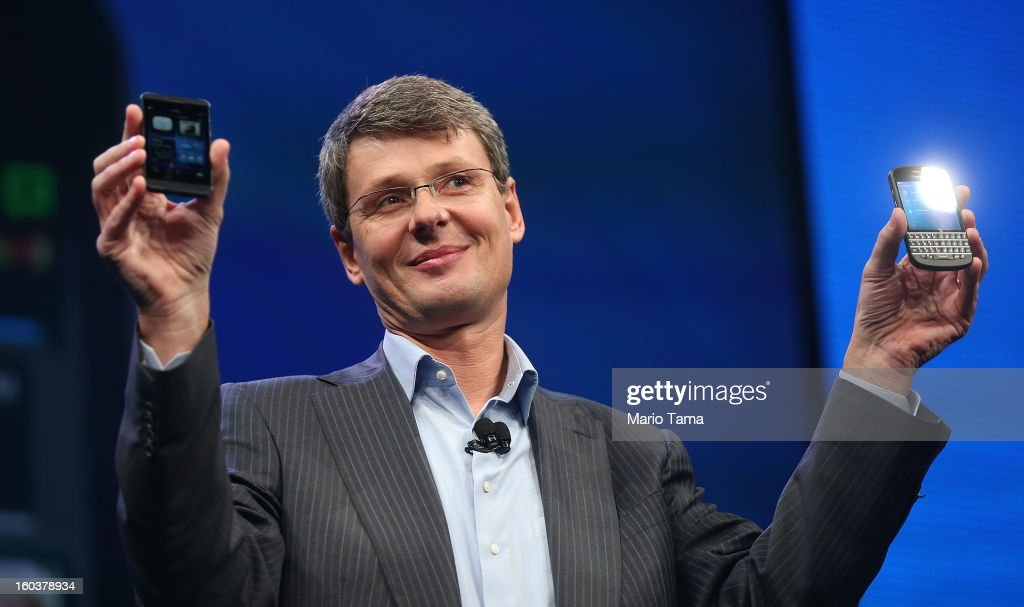 BlackBerry Chief Executive Officer Thorsten Heins displays the new Blackberry 10 smartphones at the BlackBerry 10 launch event at Pier 36 in Manhattan on January 30, 2013 in New York City. The new smartphone and mobile operating system is being launched simultaneously in six cities.