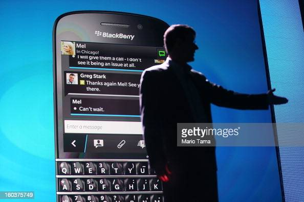 BlackBerry Chief Executive Officer Thorsten Heins speaks in front of a display of one of the new Blackberry 10 smartphones at the BlackBerry 10...