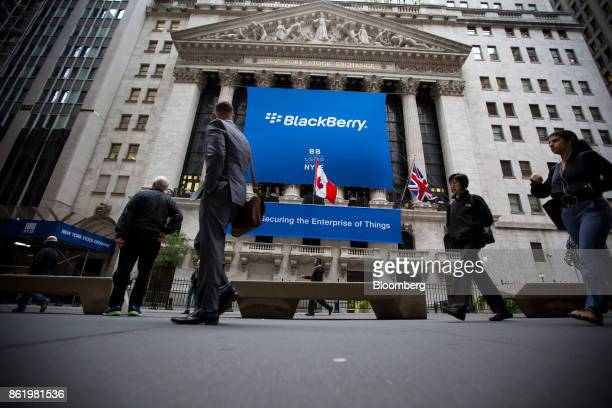 BlackBerry Ltd signage is displayed in front of the New York Stock Exchange during the company's listing migration to the NYSE in New York US on...