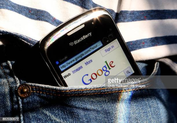 A BlackBerry phone showing the Google search engine home page as the internet giant celebrates it's 15th birthday today