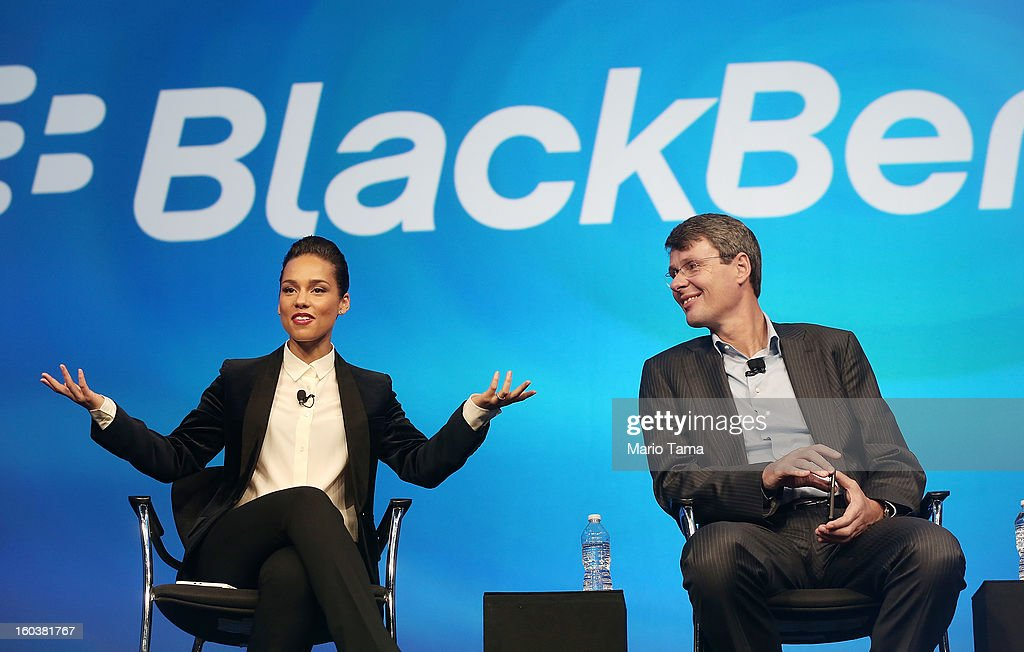 BlackBerry President and Chief Executive Officer Thorsten Heins (R) looks on as new BlackBerry Global Creative Director <a gi-track='captionPersonalityLinkClicked' href=/galleries/search?phrase=Alicia+Keys&family=editorial&specificpeople=169877 ng-click='$event.stopPropagation()'>Alicia Keys</a> speaks at the BlackBerry 10 launch event at Pier 36 in Manhattan on January 30, 2013 in New York City. The new smartphone and mobile operating system is being launched simultaneously in six cities.