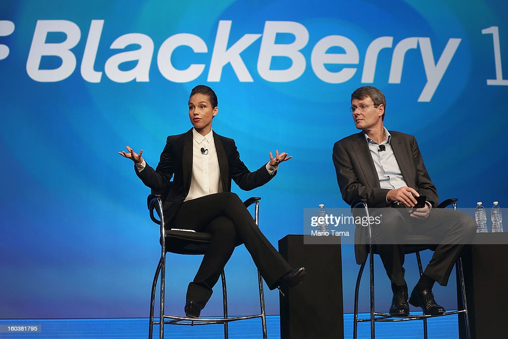 BlackBerry President and Chief Executive Officer Thorsten Heins (R) looks on as new BlackBerry Global Creative Director Alicia Keys speaks at the BlackBerry 10 launch event at Pier 36 in Manhattan on January 30, 2013 in New York City. The new smartphone and mobile operating system is being launched simultaneously in six cities.