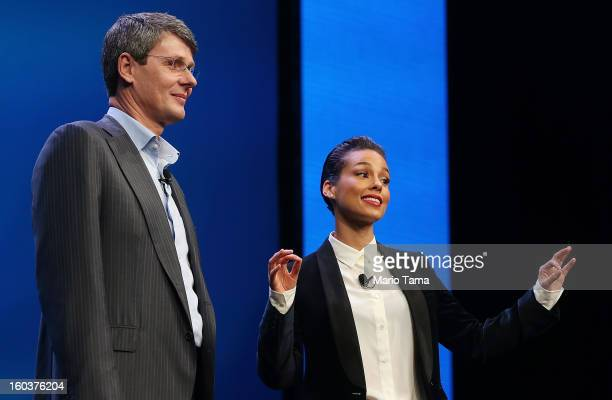BlackBerry President and Chief Executive Officer Thorsten Heins stands with new BlackBerry Global Creative Director Alicia Keys at the BlackBerry 10...