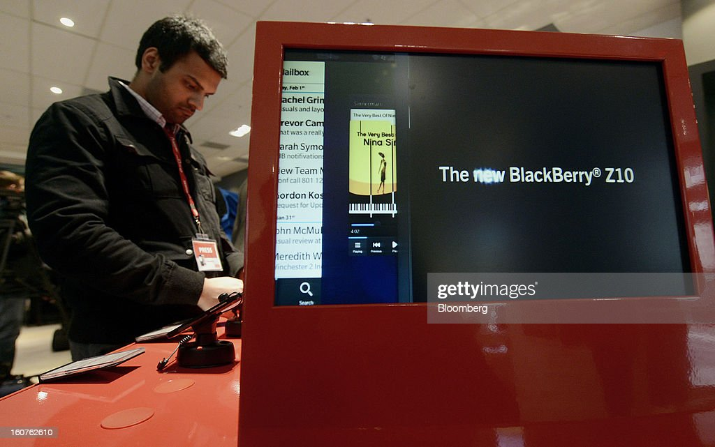 "A Blackberry Z10 display is seen on a monitor as a member of the media views the device on the first day of sales at a Rogers Communications Inc. store in Toronto, Ontario, Canada, on Tuesday, Feb. 5, 2013. Thorsten Heins, president and chief executive officer of BlackBerry, said early sales of the Z10 smartphone are ""encouraging"" and that users are switching from other platforms. Photographer: Aaron Harris/Bloomberg via Getty Images"