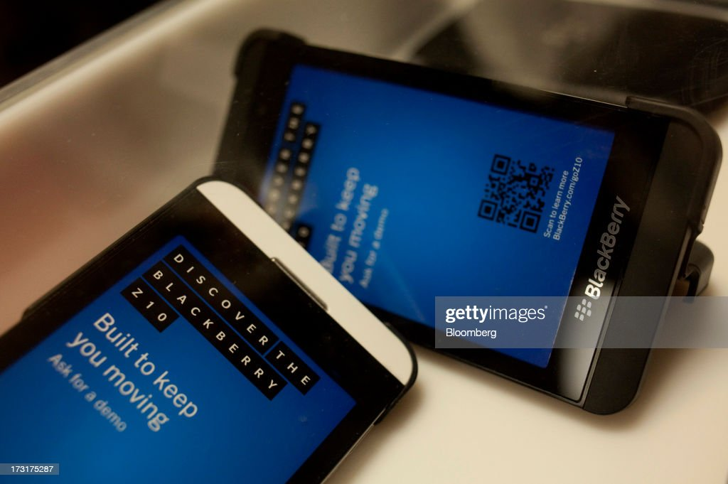 BlackBerry Z10 smartphones sit on display for demonstration prior to the company's annual general meeting in Waterloo, Ontario, Canada, on Tuesday, July 9, 2013. BlackBerrys chances of becoming a viable contender to Apple Inc. and Google Inc. in the smartphone market are dimming amid lackluster demand for its flagship touch-screen device. Photographer: Pawel Dwulit/Bloomberg via Getty Images