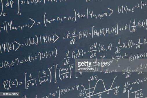 blackboard full of equations