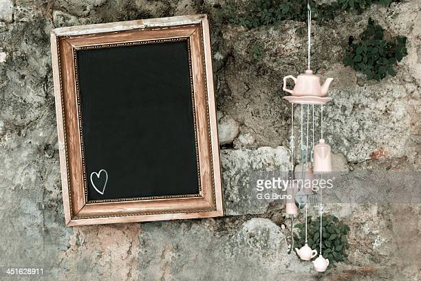 Blackboard hanging on an old stone wall